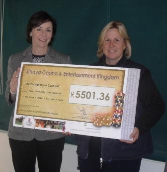 BELINDA JELF MARKETING MANAGER VISITS THE FARM IN CATO RIDGE TO HAND OVER A CHEQUE TO THE COASTAL HORSE CARE UNIT