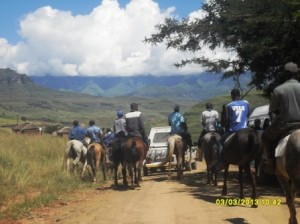 Rural Horse riders meet us on the road and Escort us all the way down the valley to the horse clinic
