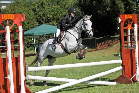In this picture is Nicole Mc Gregor, jumping to Victory on her Pony – Sheza Dreamer,  in the Summerveld Veterinary Hospital Championship PR 0.60m / PR 0.70m Class   Photo by DN Photography