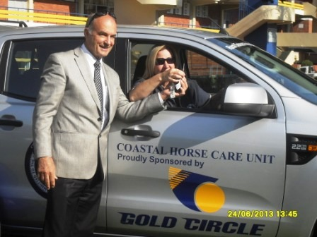 Robert Mauvis Chairman of Gold Circle hand over the keys to Gill  Olmesdahl Chairman of The Coastal Horse Care Unit